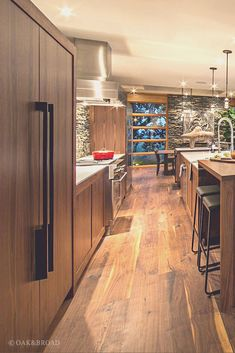 Wide Plank Black Walnut Hardwood Floor By Oak And Broad   Modern Kitchen Area With Black Walnut And Stone, Stainless Steel Appliances   Discover more at http://OakAndBroad.com/contemporary-home-black-walnut-plank-flooring/