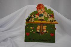 vtg valentine card German standup cardboard mechanical boy dog cat seesaw