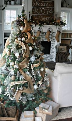 In keeping with my natural woodsy Christmas theme this year my tree has the same log cabiny snowy vibe happening. I used a lot of burlap ribbon and natural elements like pine cones.