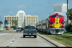 The Galveston Railroad Museum's Santa Fe painted F-units return to the museum, covering the last few hundred yards on tracks belonging to Union Pacific. The impressive structure in the rear of this image is the head house for the former Santa Fe station.