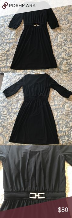 White House Black Market black dress Black quarter length sleeved dress with silver buckle. Only worn a few times, excellent condition! Or best offer! White House Black Market Dresses