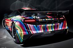 Rainbow-coloured: Inspired by the classic BMW Art Cars of the 1970s, Hamann Motorsport has transformed the 12C, built in Woking, Berkshire, into an eye-catching coupe