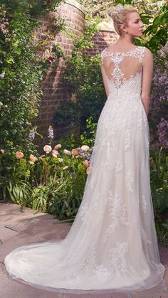 10 Boho Wedding Dresses by Rebecca Ingram - Illusion lace in a chic back treatment. Alexis by Rebecca Ingram is lovely for a garden wedding or beach soiree. Head to an Authorized Retailer for more budget-friendly gowns!