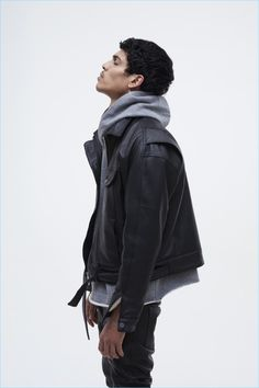 Sporting a leather jacket with a hoodie, Geron McKinley appears in Fear of God's fall-winter 2017 lookbook.