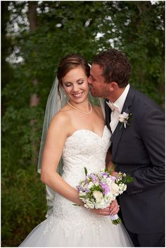 Groom kisses his wife to be on teh cheek as she smiles at Medina Country Club Wedding
