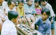 Children in Indonesian villages enjoy the traditional game of congklak