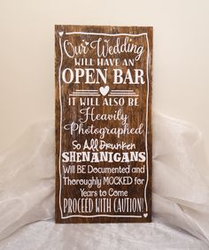 Our Wedding Will Have An Open Bar So ALL Drunken Shenanigans Will Be Document and Thoroughly Mocked For Years To Come Proceed With Caution Wedding Sign, Alcohol Wedding Sign, Open Wedding Bar Sign. This wooden sign is approximately 12 x 24 x 3/8 inches in size. The board is aged for a shabby chic/reclaimed wood look. We offer the sign color in Distressed Wood, Brown Stain, and Black Stain. Please make sure to select this option during checkout. The graphic is done in white vinyl. The sign…