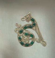 """""""Celtic Hound from the Book of Kells in Sterling Silver set with Green Onyx"""" by simonsdesign '"""