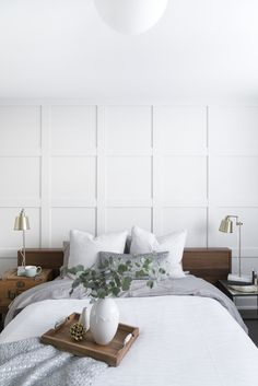 Guest bedroom with brass accents and classic wall moulding. Guest bedroom with brass accents and classic wall moulding. Dream Bedroom, Home Bedroom, Master Bedroom, Bedroom Decor, Bedroom Ideas, Girls Bedroom, Wall Behind Bed, Accent Wall Bedroom, Bedroom Wall Panels