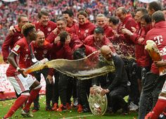 Best of 2016 -  Bayern Munich's Austrian defender David Alaba (L) gives a beer shower to Bayern Munich's Spanish head coach Pep Guardiola after the German first division Bundesliga football match between FC Bayern Munich and Hannover 96 in Munich, southern Germany, on May 14, 2016. Bayern Munich won the German league for a record 4th time in a row. #fys #Football #BayernMunich #topshot