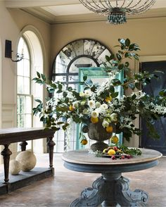 Dreaming of this beautiful wintry floral arrangement by @arieldearieflowers that @verandamag commissioned for a story a few years ago. Among other things, two of my favorites together: citrus and camellia. Photo: David Meredith.