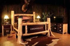 Cedar log bed with Chevrolet tailgate.