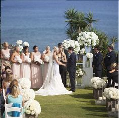   aboutdetailsdetails.com   wedding ceremony, no canopy, outdoor wedding, outdoor ceremony, no frame, simple and sweet ceremony, trumpet mermaid wedding dress, long wedding veil, light pink bridesmaids dresses, tall white floral centerpieces, large white aisle bouquets, beach view, ocean front wedding, southern california wedding, so cal wedding