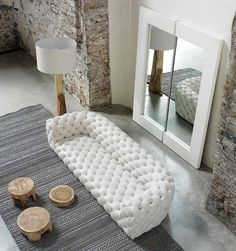 Chester Moon Sofa by Baxter Decalz The traditional technique of tufted leather made contemporary.