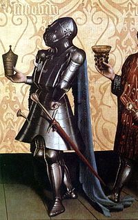 Knight wearing a great bascinet, the strap fixing the helmet to the breastplate is visible as is the impossibility of rotating the helmet, German painting of 1435, by Konrad Witz