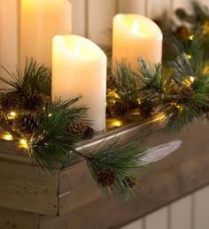 Add a charming twinkle to your home with this beautiful lighted pine cone garland. This versatile garland is battery-powered for easy use anywhere–put it on your mantel, hang it on a wall or use it on a table for gorgeous glowing effect. Pre Lit Garland, Light Garland, Christmas Wreaths, Christmas Decorations, Christmas Ideas, Candle Decorations, Christmas Plants, Cabin Christmas, Christmas Centerpieces