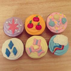 My Little Pony Cupcakes, by Rosanna Pansino on Nerdy Nummies. Check out the cutie mark apron she's wearing in the video - isn't it adorbs??
