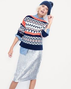 J.Crew women's festive Fair Isle sweater, silver sequin skirt and ribbed hat with faux-fur pom-pom.