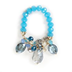 This stylish cluster stone bracelet will look simply stunning on your wrist. The bracelet is designed with faceted stones of varying lengths and shades. Stretches to fit most wrists.
