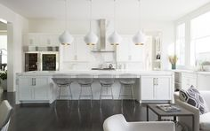 White chandeliers in the kitchen would add elegance to your space.