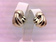 A pair of Sterling Silver earrings. Very light despite their size.