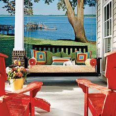 A porch swing invites you to take full advantage of coastal breezes | Coastalliving.com