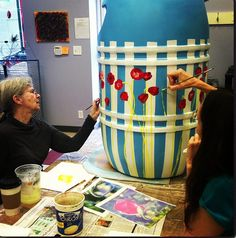 Red Poppy rain barrel painted by some of our talented artists-this auctioned off for support of Paint the Rain