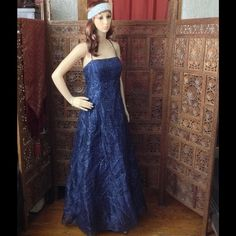 Pretty blue sparkly long gown Betsy and Adam by Jasline floor length gown with criss cross open back and ties.  Structured boning within the bodice, with pretty, glitter details. Betsy & Adam Dresses