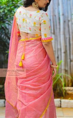 PV 4199 : White and PinkPrice       : 4100 Rs.Pink coloured soft self patterned tissue sari finished with mustard yellow border.Unstitched blouse