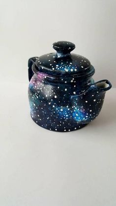 A Porcelain galaxy teapot (310ml / 11oz) hand painted with love by Helen Nesta at the Mad Hatters Tea Room Southport. For matching items, see my etsy shop or Facebook page - teapots, cups and saucers, milk jugs, mugs, gravy boats and more! Care instructions To clean: wash gently in warm soapy water. Not dishwasher safe. Not microwave safe. Not freezer safe. Please Note The paint used for this item is non-toxic. Not intended for everyday use; excessive use or rough cleaning can wear aw...