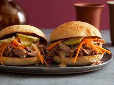 """Classic Chinese flavors served as Jeff Mauro's inspiration for these addictive sliders. """"I love the succulent pork coupled with the tangy and crunchy veggies and hot-and-sweet mustard,"""" says the Sandwich King."""