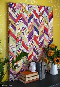 """WITHOUT A STITCH ~ NO SEW  Tasteful Textiles """"Fabric art"""" is a great way to create a contemporary atmosphere and tie together other elements in the room. Choose fabrics that complement your throw pillows, window treatments, or area rug, then simply wrap them around a wooden frame and staple to secure."""