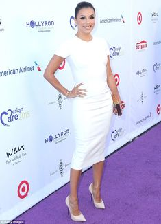 A bit of all white:Eva Longoria doesn't need to flash her flesh to show off her beautiful body as she proved on Saturday when she wore a skin-tight dress for the HollyRod Foundation's DesignCare Gala in Los Angeles