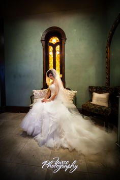 Elegant pose for your bridal portrait session to highlight your wedding gown and train. This is from an indoor mixed light session posed on a couch.