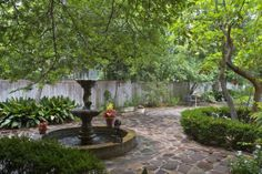 A New Orleans-style courtyard with flagstone pavers and a deep fountain pond populated with koi makes a relaxing spot to spend the morning or late evening.