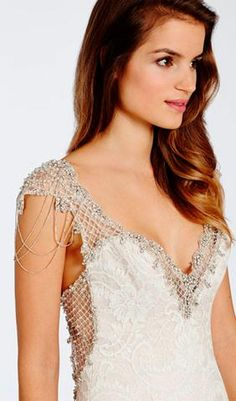 Try this beautiful Ivory French corded lace over Rum Pink Charmeuse soft fluted wedding dress. Sheer jeweled and embroidered deep sweetheart neckline with chandelier embroidered cap sleeves. From Alvina Valenta. Available at Schaffer's in Des Moines, Iowa. Wedding Dress Info: Alvina Valenta – STYLE 9511.