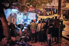 Sports, 2nd prize stories. A group of people watch the wrestling match on television in Dakar, Senegal, April 4, 2015.