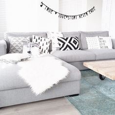 Grey sectional, pillows,