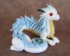 Arteth by DragonsAndBeasties.deviantart.com on @deviantART White dragon holding orb