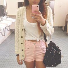 .pink high wasted shorts. cream cardigan
