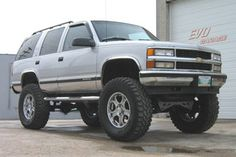 1996 Chevy Tahoe ton with suspension & body lift, Pro Comp Xterrain w/ American Racing wheels Lifted Chevy Trucks, Ford Pickup Trucks, Gm Trucks, Chevy Pickups, Chevrolet Suburban, Chevrolet Tahoe, Lifted Chevy Tahoe, American Racing Wheels, Pro Comp