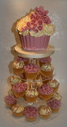 A cupcake tower with a giant cupcake on top. I have a stand that you could borrow. 21st Birthday Cupcakes, 21st Cake, Wedding Cupcakes, 28th Birthday, Birthday Ideas, Giant Cupcake Cakes, Large Cupcake, Cupcake Bakery, Beautiful Birthday Cakes