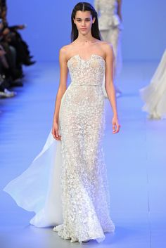 Elie Saab Spring 2014: White is beautiful for spring! I love the texture of the gown! Exquisite!