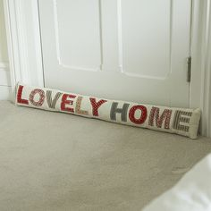 "Patchwork ""Lovely Home"" Draft Excluder. My house is super drafty so I really like the idea of this, I think for mine, it'll say ""baby it's cold outside"" .. :)"