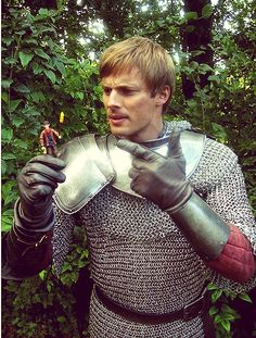Bradley James as Arthur Pendragon and a Merlin action-figure. I just started watching merlin, so yay! i can repin merlin things now! The show's really great so far, guys. Thanks to all you merlin pinners for introducing me to the show. :)