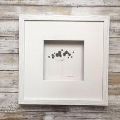 Pebble Art minimal botanical by Sharon Nowlan, flower pebble art comes matted or framed in 12 by 12 frame. by PebbleArt on Etsy https://www.etsy.com/listing/506776796/pebble-art-minimal-botanical-by-sharon