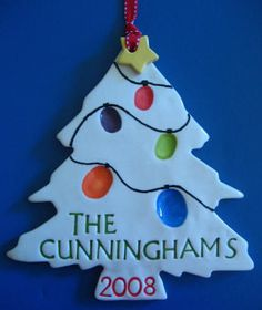 Fingerprint or thumbprint Christmas lights on Personalized Christmas Tree Ornament with Family Name & Year.  Make sure to include names of prints on back or next to print.