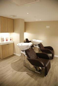Our new hair washing chairs melt into beds and give you massages!