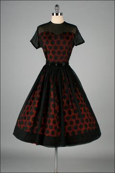 Vintage 1950s Red Polka Dot & Black Chiffon Dress. Isn't this the way one should do see through rather than a mini skirt under a long see through skirt. It looks so stupid that way.