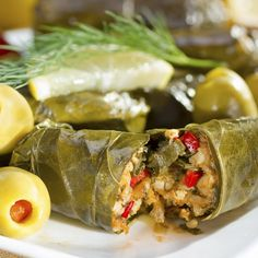 This recipe for Dolmades Stuffed Grape Leaves is made with a rice filling.. Dolmades Stuffed Grape Leaves Recipe from Grandmothers Kitchen.